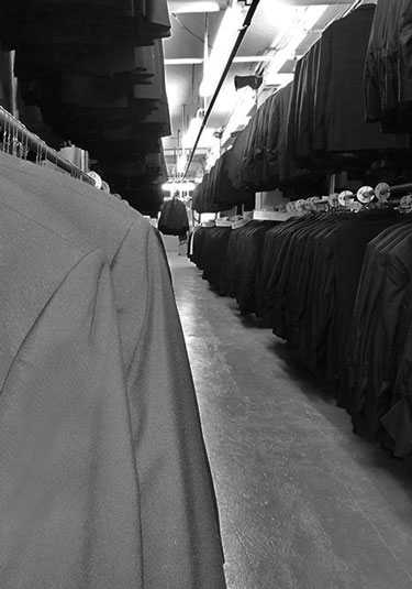 tip top tux coats hanging in production warehouse